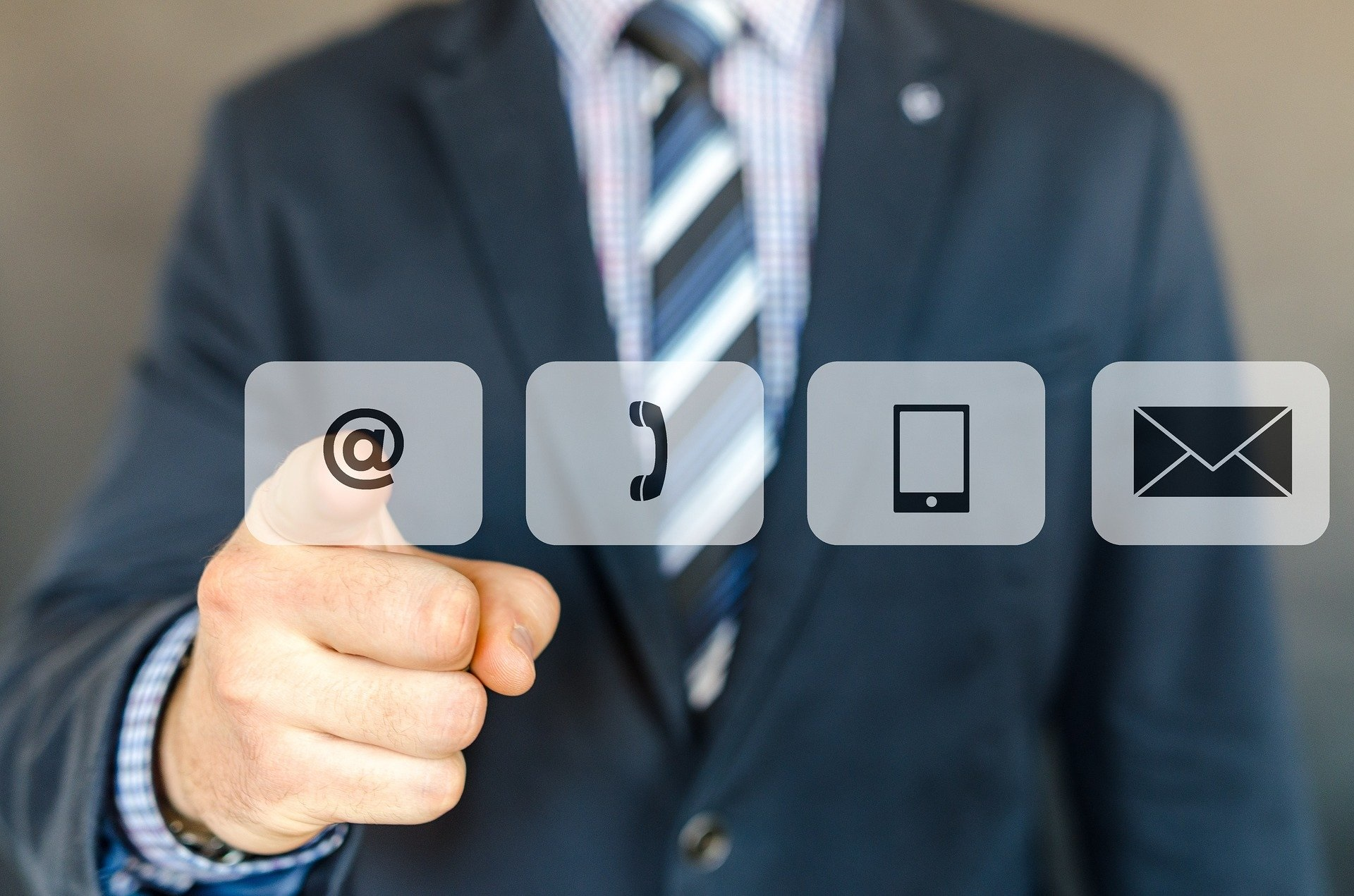 outside sales professional in a blue suit selecting internet icon, with 4 icons for internet, phone, mobile app, and email